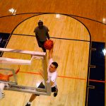 Man attempting dunk at Late Night