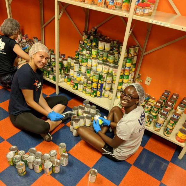2 lady roadrunners stocking canned food