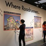 2 students at Gallery 23 exhibit about where UTSA students come from